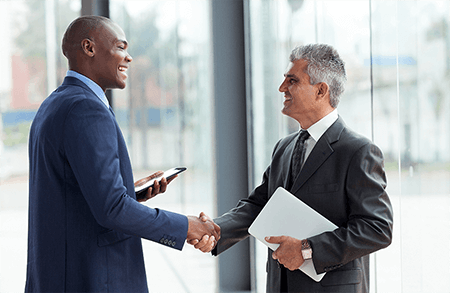 wealth managers shaking hands